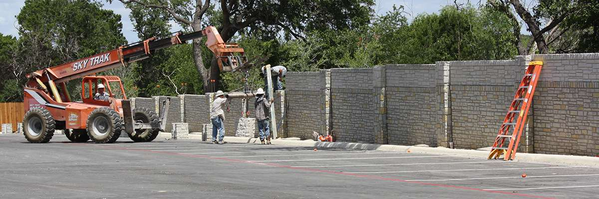 Men building wall